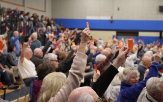 Voters hold up their tickets at Saturday's special town meeting.  ALAN POLLOCK PHOTO  (photo: Alan Pollock)