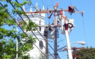 Utility workers in downtown Chatham.  FILE PHOTO  (photo: Tim Wood)