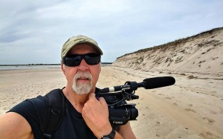 "Jan ""JC"" Crocker on Monomoy with his video camera. COURTESY PHOTO  (photo: )"