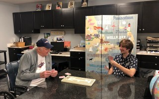 Liberty Commons activities assistant Seth Franco plays cards with resident Richard Bernard. COURTESY PHOTO  (photo: )
