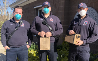 Orleans firefighters Ben Nickerson, Brandon Henderson and Dana Medeiros with care packages from Snowy Owl Coffee Roasters. COURTESY PHOTO   (photo: )