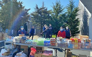Masks and social distancing in evidence among volunteers at a Lower Cape Outreach Council food distribution. LOWER CAPE OUTREACH COUNCIL PHOTO  (photo: )