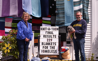 Mary and Ron Weishaar, owners of A Great Yarn in Chatham, celebrate the completion of their 2020 Knit-A-Thon on May 3 with their annual yarn bombing of the shop on Route 28. Kat Szmit Photo  (photo: )