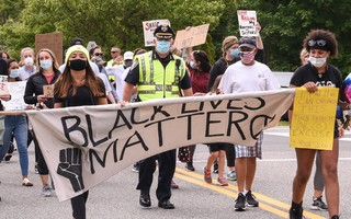 Harwich Chief David Guillemette walks with protesters during a march in Harwich Center June 6. KAT SZMIT PHOTO  (photo: )