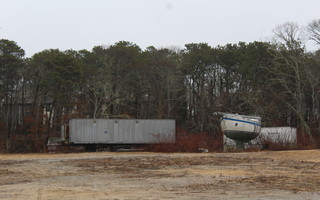 The boat and trailers, stored on the residentially zoned portion of the Emulous Hall Realty Trust property where a variance has now been approved to locate and 18-hole miniature golf course, will be removed as the project moves forward. WILLIAM F. GALVIN PHOTO  (photo: William F. Galvin)