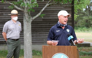 Orleans Beach Safety Director Tony Pike addresses a socially distant news conference last week, with Cape Cod National Seashore Superintendent Brian Carlstrom in the wings. ALAN POLLOCK PHOTO 