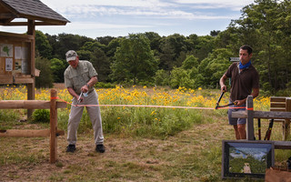 Harwich Conservation Trust President Tom Evans joins Don Marini, whose family once owned the land, in officially opening the new Muddy Creek Headwaters Preserve in Harwich, which includes a walking trail and a wildflower meadow. Kat Szmit Photo  (photo: )