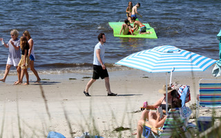 Beachgoers enjoy sun, surf and social distancing in Harwich Port.  ALAN POLLOCK PHOTO  (photo: )
