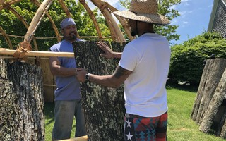 David and Attaquin Weeden assemble a Wampanoag wetu on the grounds of the Atwood Museum on Stage Harbor Road. COURTESY CHATHAM HISTORICAL SOCIETY  (photo: )