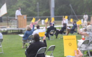 For the first time ever, voters met at an outdoor town meeting on June 22. Much of the business of that meeting was postponed until the fall, but selectmen are considering carrying those measures over to next May's annual meeting. FILE PHOTO  (photo: )