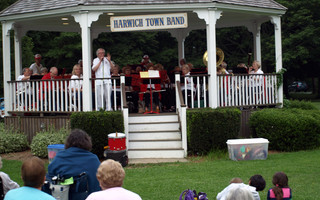 The Harwich Town Band performing at Brooks Park in less social distant times. The band will start weekly concerns once again on Aug. 4. FILE PHOTO  (photo: )