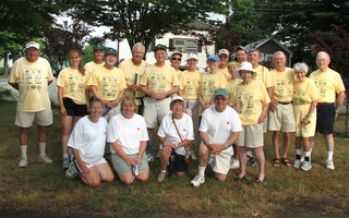 The Housing with Love Walk in 2010.  It now bears the name of event organizer Bob Murray (standing, sixth from left), who died in 2013.  FILE PHOTO  (photo: Alan Pollock)