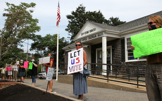 Protesters stood in front of the main Chatham Post Office Saturday. ALAN POLLOCK PHOTO 