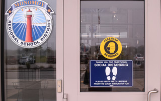 New signs affixed to the doors of Monomoy Regional High School alert students, staff, and visitors to the new mask and social distancing protocol, in keeping with the school's reopening plan. Kat Szmit Photo  (photo: )