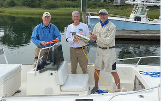 Bob Wilson, Joe Meeks and Joe Roller set out to gather samples in Ryder's Cove. 