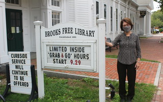 Brooks Free Library Director Ginny Hewitt is pleased with the plan to open the library doors to patrons once again. WILLIAM F. GALVIN PHOTO  (photo: William F. Galvin)