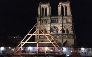 On Saturday night in Paris outside Notre Dame cathedral, a truss built with traditional tools and methods by Carpenters Without Borders offered a sign of hope that the fire-damaged landmark can be rebuilt in an historically appropriate manner. FRANCOIS CALAME PHOTO  (photo: Francois Calame)