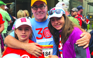 Alexa and Sienna Azure share a moment with their father Darrell at the 2018 Jimmy Fund Walk in support of the Dana-Farber Cancer Institute, where Darrell was a patient. They will take part in the 2020 event in his honor. CONTRIBUTED PHOTO  (photo: )