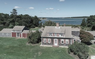 Thousands of yards of fill is proposed to be brought in to elevate this Pleasant Bay-front property in North Chatham. The historic old home shown here, one of the oldest in Chatham, is proposed to be moved elsewhere on the property and a new house built in its place. COURTESY PHOTO  (photo: )