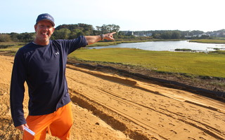 Jeff Handler stands on the newly remediated grounds of the Handler Auto Parts property along Route 28 in Harwich Port. The 3.14-acre parcel has been cleaned of heavy metals and old auto parts in advance of future development there. WILLIAM F. GALVIN PHOTO  (photo: William F. Galvin)