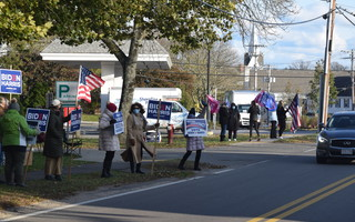 Democratic and Republican supporters outside the Chatham Community Center Tuesday. TIM WOOD PHOTO  (photo: )