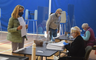 Chatham voters check out after filling out their ballots. TIM WOOD PHOTO  (photo: )