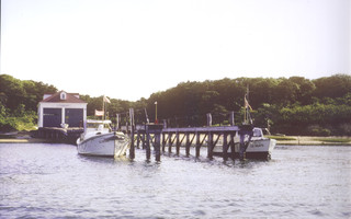 The Gold Medal lifeboat CG36500 sits alongside the pier at the Stage Harbor Coast Guard boathouse in this undated photograph. Efforts are underway to move the boathouse back to Chatham. FILE PHOTO  (photo: )