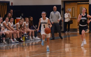 Monomoy girls basketball coach Pete Richer keeps an eye on Lucy Mawn as she moves the ball into scoring territory during a game last season. Richer recently announced that he'd be stepping down due to the demands of his landscaping business. File Photo  (photo: )
