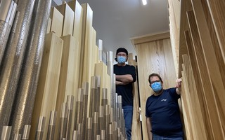 Dominique Thouin, left, and Sébastien Kardos of Casavant Freres with the church's new organ. COURTESY PHOTO  (photo: )