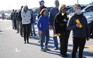 Voters in the Oct. 31 Orleans special town meeting checked in with the town clerk before the meeting convened at the Nauset Beach parking lot.  FILE PHOTO  (photo: Barry Donahue)
