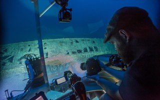 Joe Hoyt, Maritime Archaeologist with the NOAA Office of National Marine Sanctuaries, takes photos of the shipwreck from the submersible. Image courtesy of Carmichael, Project Baseline - Battle of the Atlantic expedition.  (photo: NOAA Office of Ocean Exploration and Research)