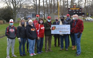 Orleans Firebirds president Bob O'Donnell and the club presented the town of Orleans with a $40,000 check during a ceremony Monday morning at Eldredge Park. The moneywill help offset the town's costs to fully recondition the lights at Eldredge Park. BRAD JOYAL PHOTO  (photo: )