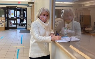 Mary Anderson takes out nomination papers at the town clerk's office on Tuesday for a seat on the board of selectmen. COURTESY PHOTO  (photo: )