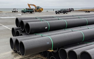 The dredge pipes were assembled at the second parking lot at Harding's Beach, where town officials have proposed storing them on a long-term basis. FILE PHOTO  (photo: )