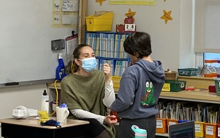 While older students swab their own noses for the tests, school nurses help younger children. COURTESY PHOTO 