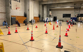 Volunteers set up the vaccine site in the gymnasium of Cape Cod Community College earlier this week. As of Tuesday, no opening date had been announced. COURTESY CAPE COD HEALTHCARE  (photo: )