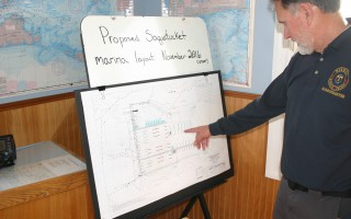 Harbormaster John Rendon reviews a schematic plan of proposed Saquatucket Harbor landside improvements.  FILE PHOTO  (photo: William F. Galvin)