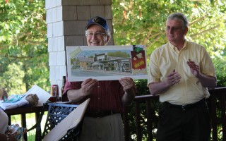 Town Planner David Spitz is presented with a Milton Welt print of Harwich Port during his retirement party on Thursday at the Cranberry Valley Golf Course clubhouse. Town Administrator Christopher Clark is by his side. WILIAM F. GALVIN PHOTO  (photo: William F. Galvin)
