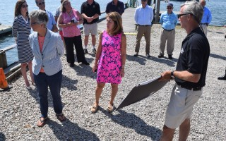 Coastal Resources Director Ted Keon, right, shows plans for improvements at Old Mill Boatyard to Lt. Governor Karyn Polito, center, and State Representative Sarah Peake, D-Provincetown, during a tour of the facility last week. Bids for the project opened later in the week came in above avaiilable funding. TIM WOOD PHOTO  (photo: )