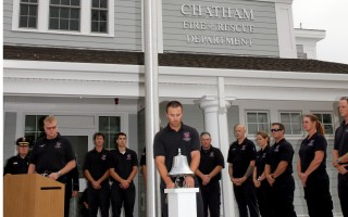 Firefighter Justin Tavano tolls the bell in honor of fallen comrades.  ALAN POLLOCK PHOTO  (photo: Alan Pollock)