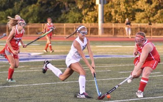 Monomoy's Emma Mawn (4) seizes control of the ball in a field hockey battle against Barnstable on Monday night. Kat Szmit Photo  (photo: Kat Szmit)