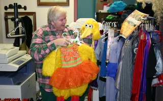 "Carolyn Carey sorts costumes at last year's ""Boo-tique."" Donated costumes are now being accepted at the community center, and will be made available to local kids in need of a Halloween disguise on Friday, Oct. 21. FILE PHOTO  (photo: )"