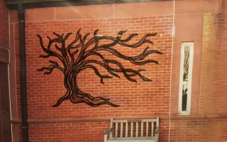 "An illustration of how the planned ""Tree of Life"" sculpture will appear on a wall at the Eldredge Public Library. COURTESY PHOTO  (photo: )"
