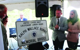 Robin Burns and her son Chris Ohman (on left) and Rusty Burns and Laura Morris at the unveiling on Saturday of the Ralph Wallace Burns Memorial Bridge sign to be located at the Route 124 bridge over Route 6. WILLIAM F. GALVIN PHOTOS  (photo: )