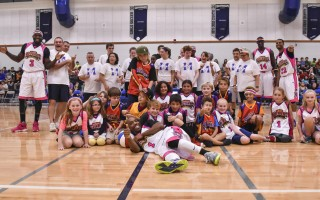 The Wiz Kids and the Monomoy All-Stars join the Harlem Wizards for a group photo during an evening of fun and fundraising last Thursday. Kat Szmit Photo  (photo: Kat Szmit)