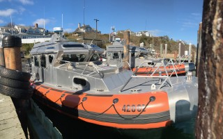 The U.S. Coast Guard's two 42-foot nearshore lifeboats at the fish pier's north jog. With docking space at the pier at a premium, town officials are considering not renewing the agency's lease on the space and searching for an alternate location to berth the boats. TIM WOOD PHOTO  (photo: )