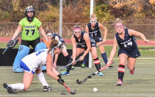 A host of Monomoy defenders, including goalkeeper Tessa Richardson (77), Colleen Cronin (7), Hannah Potter (5), Carly Donovan (11), and Marina Small (14) work to stop a Scituate foe from scoring during the MIAA Div. 2 South tournament.  Kat Szmit Photo  (photo: Kat Szmit)