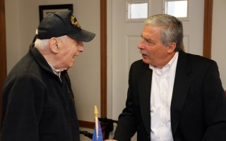 Chatham's Harvey Seltzer (left), who served in the European Theater of World War II, was among those who made an Honor Flight to Washington. He chats with Honor Flight New England founder Joe Byron.  ALAN POLLOCK PHOTO  (photo: Alan Pollock)
