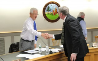 Harwich Town Administrator Christopher Clark shakes hands with Yarmouth Selectman Norman Holcomb at the conclusion of his interview for the town administrator's position there on Saturday. WILLIAM F. GALVIN PHOTO  (photo: William F. Galvin)