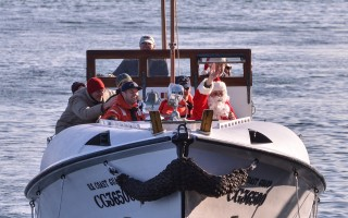 Santa arrived at the fish pier last year. He'll be back again this Sunday, once again traveling in style aboard the famous rescue boat CG36500. KAT SZMIT PHOTO 